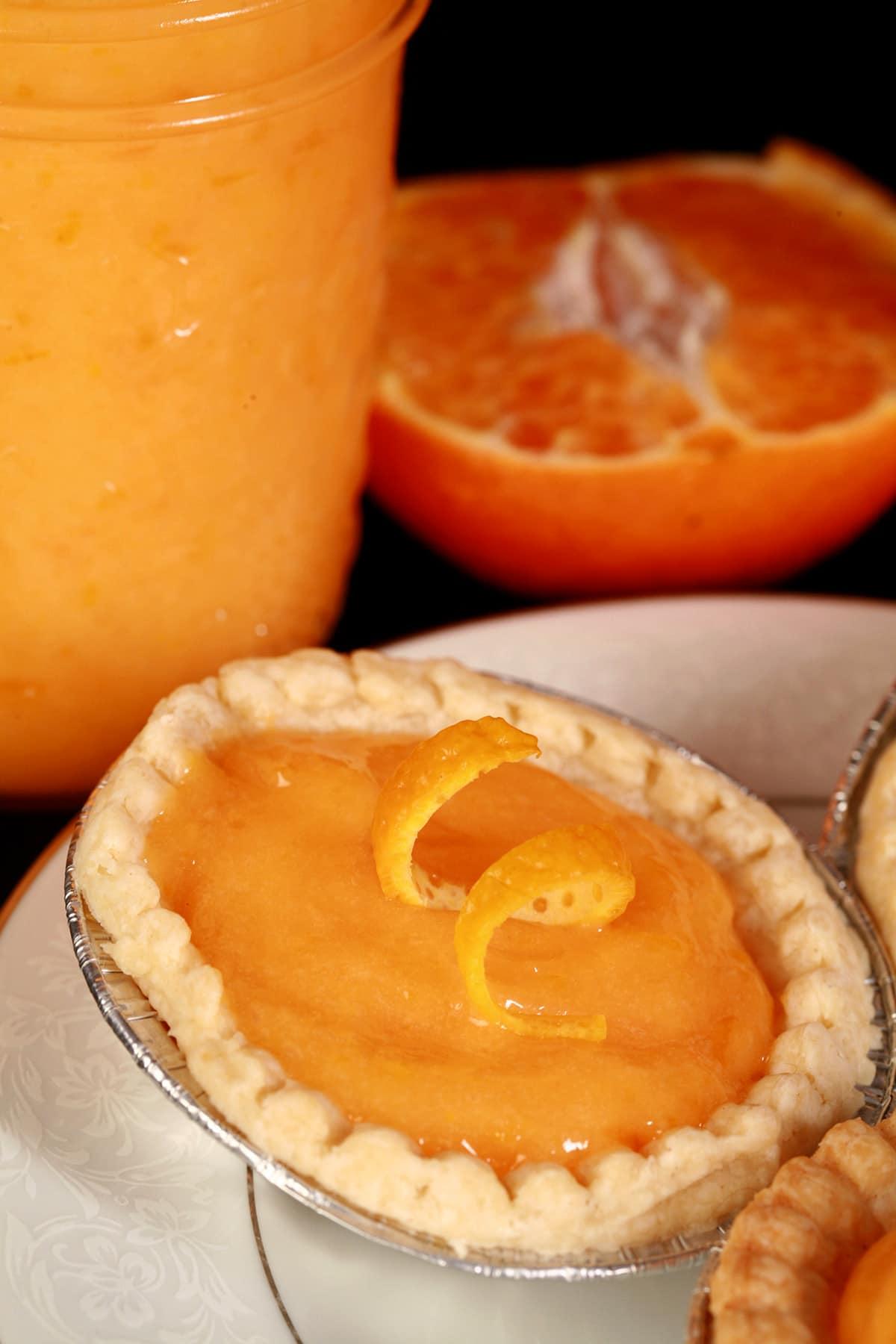 An orange tart on a plate.