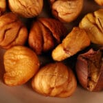 A bowl of peeled oven roasted chestnuts.