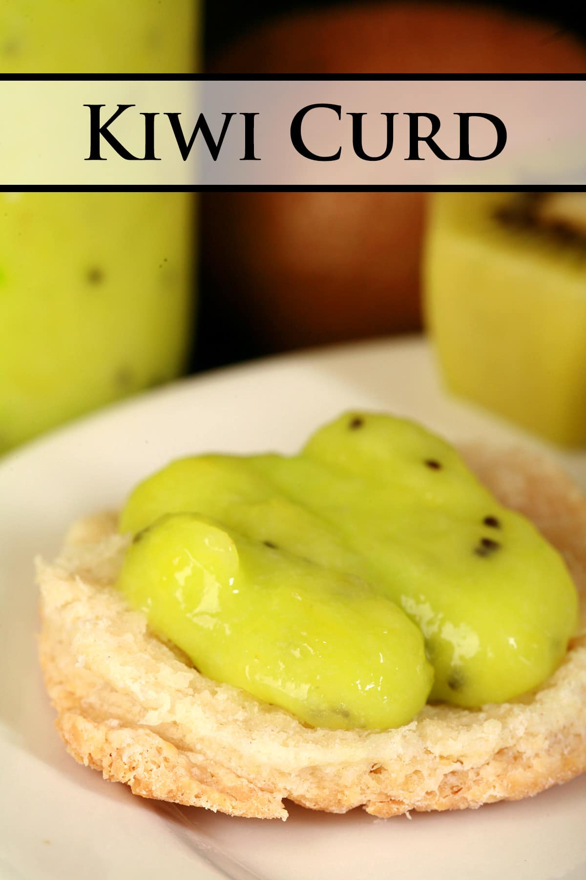 A close up view of a biscuit topped with kiwifruit curd.