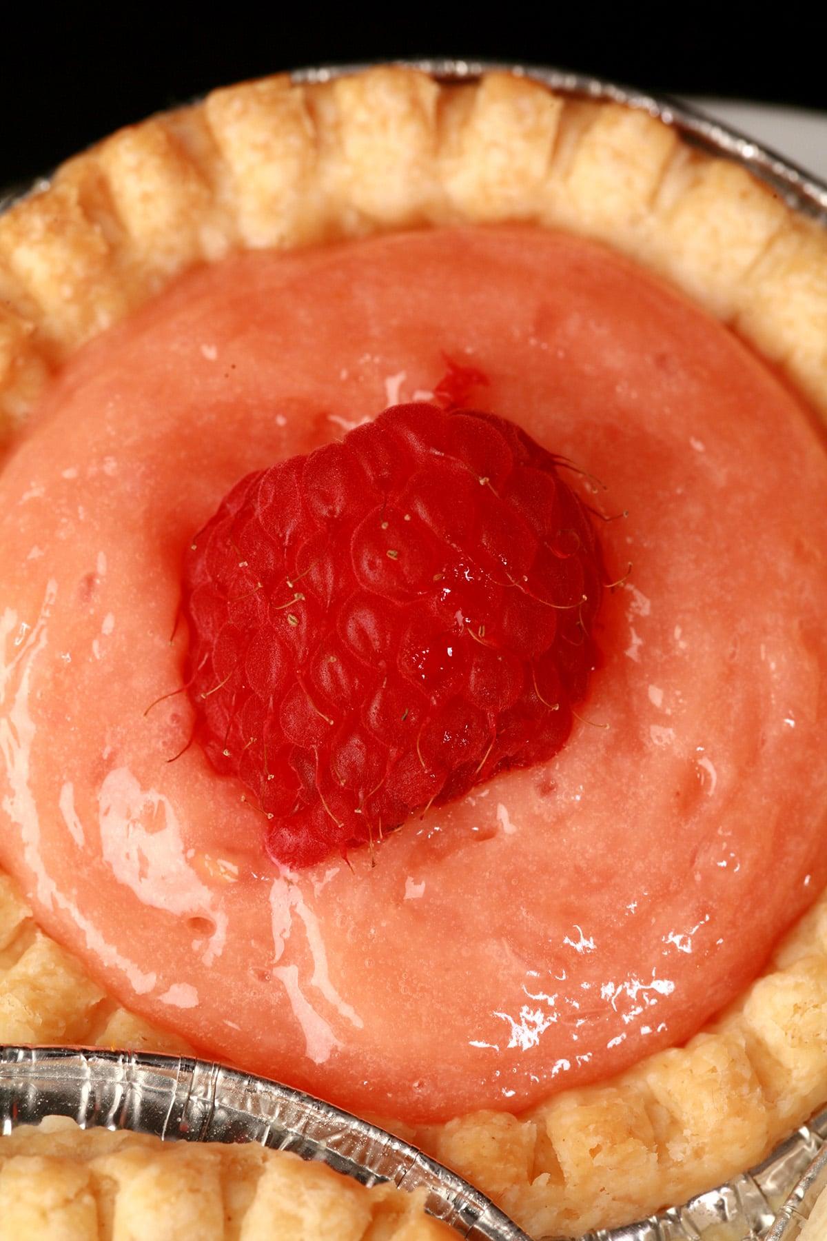 A close up view of a raspberry tart.